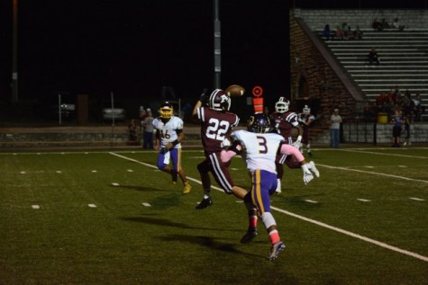 Jake Martinez (22) catches a pass and runs it in for a touchdown.