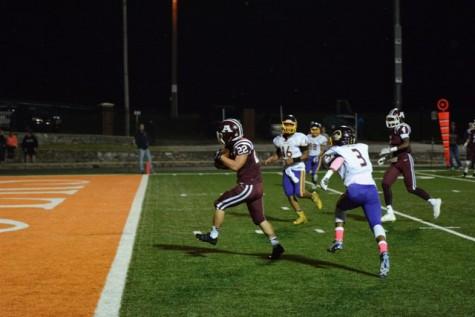 Jake Martinez runs the ball for an Ada touchdown.