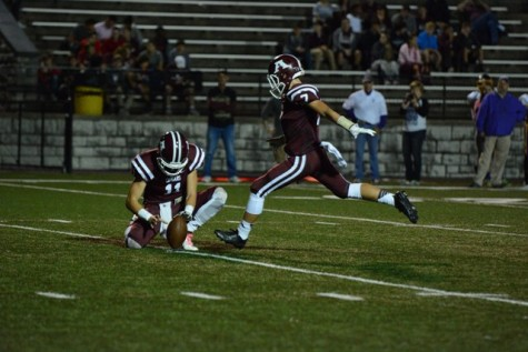 Jackson McFarlane (7) attempts the point-after-touchdown.