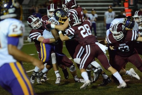 A host of Ada Cougars, including Vaughn Appleman (8), Reed Townsend (28), Levi Grimes (20) and Christian Maloy (2), make the tackle for a Bristow loss.