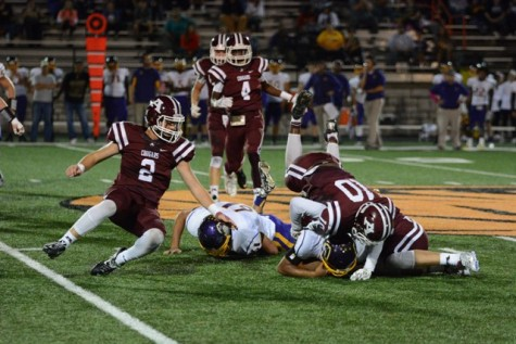 Grant Bellard (10) and Vaughn Appleman (8) bring down the Bristow ball carrier while Christian Maloy (2) holds off an additional Bristow offensive player.