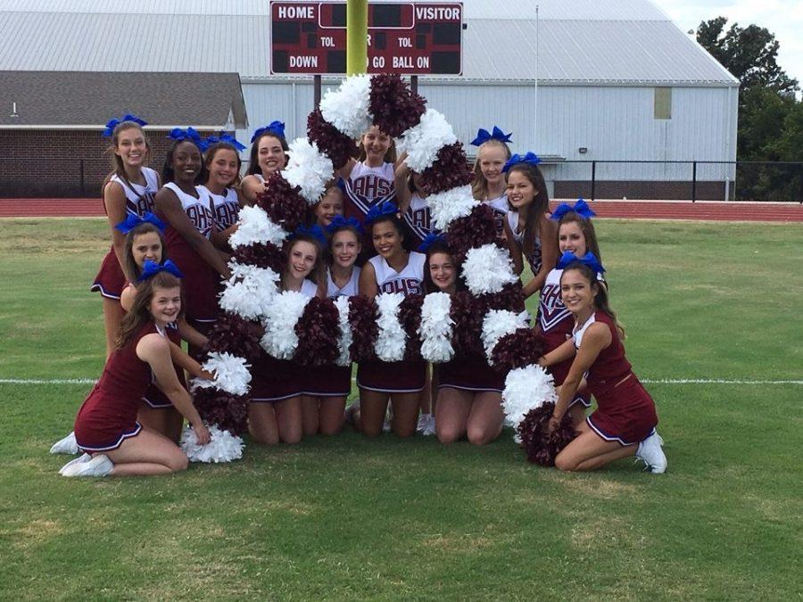 AHS+Cheerleaders+pose+at+media+day+in+early+August+2016.+