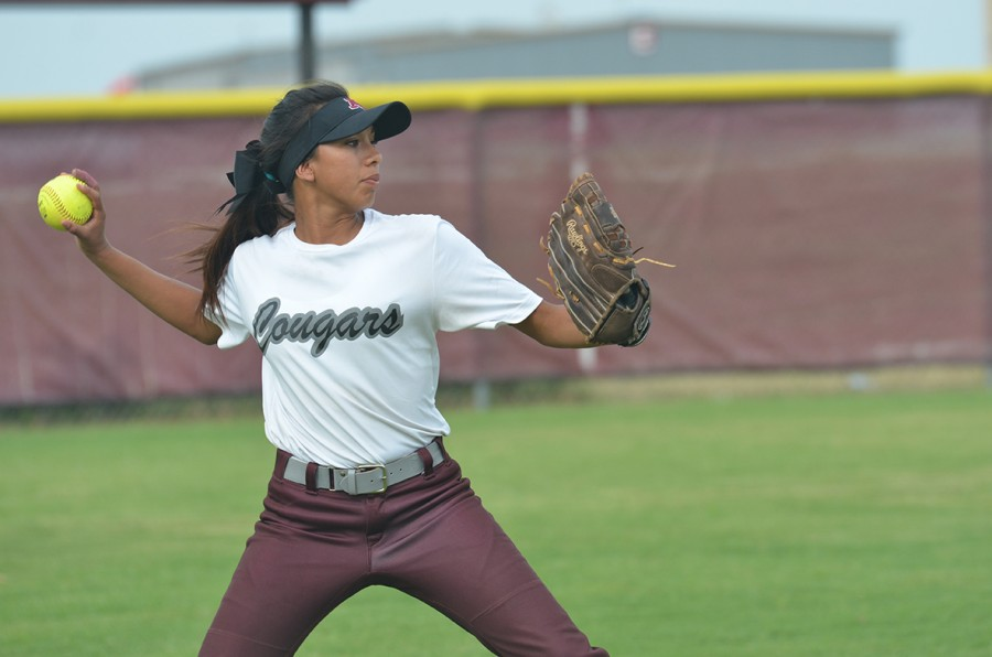 Number two, Krysten Wallace, makes a throw from right field.