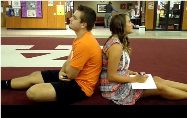Justin Miller and Braylee Belcher participate in The Cougar Call Couples Quiz