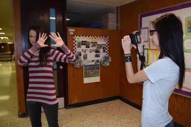 Tiyanna Melendez tries to take a picture of of an uncooperative student.
