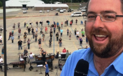 Band Director Eric Hall takes a selfie with Ada High Band