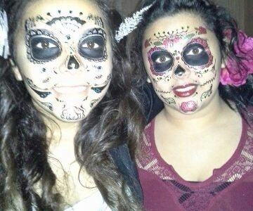 Iris Arredondo and Graciela Chapa celebrating Day of the Dead, dressed as Sugar Skulls.