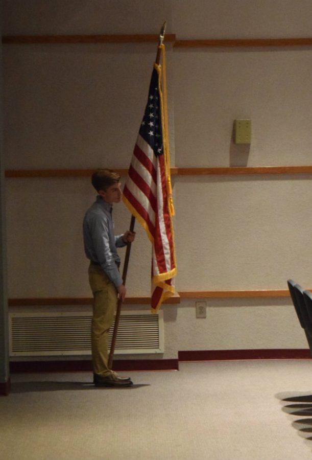 Jacob Thorley holding the American Flag