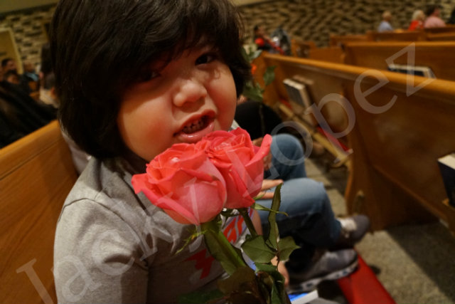 Ricky Lopez showing off his roses that he got.