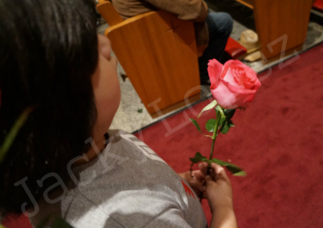 Ricky Lopez waits in line to place the rose to Mama Lupita