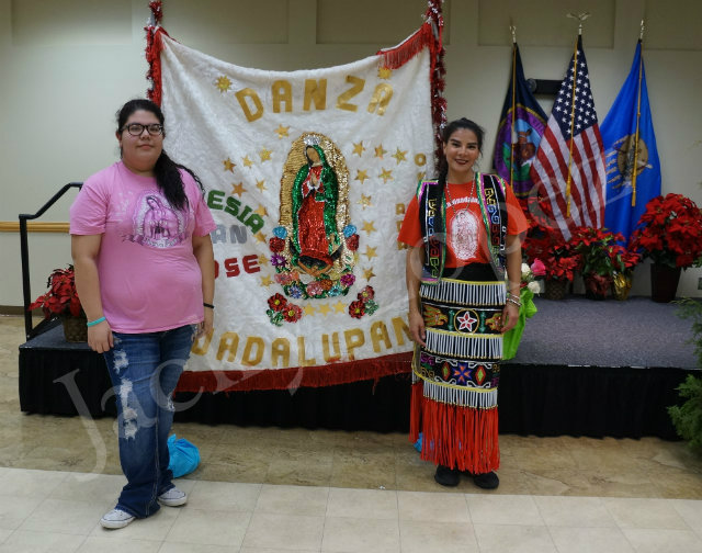 Jacky Lopez and Erika Oseguera posing with the Guadalupana blanket