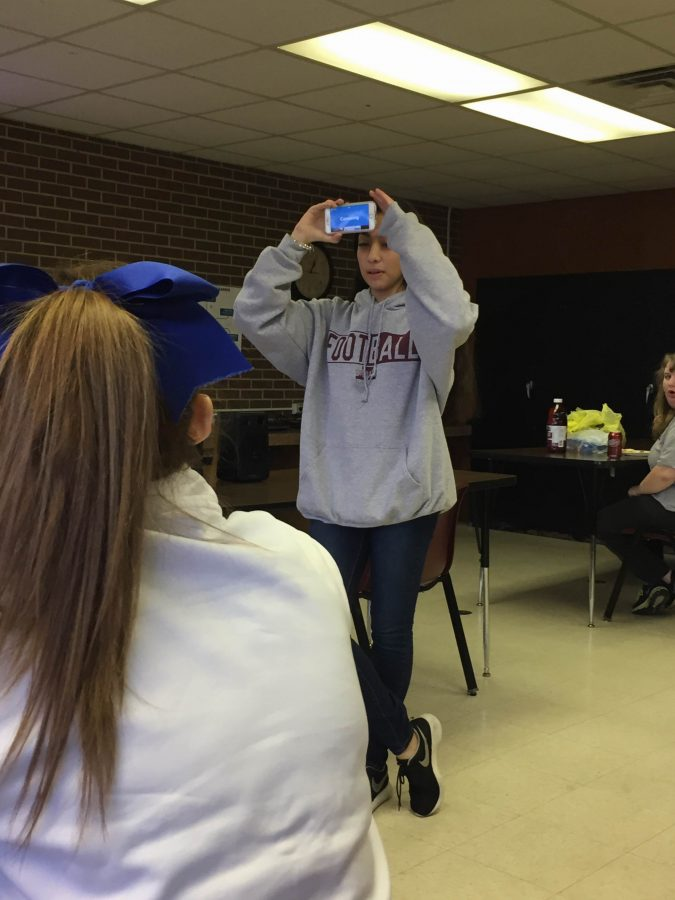 AHS student playing Heads Up at F.C.C.L.A lunch