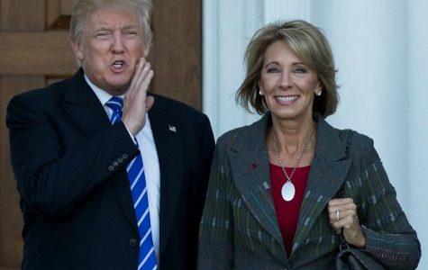 Newly elected Secretary of Education Nancy DeVos stand alongside President Donald Trump.