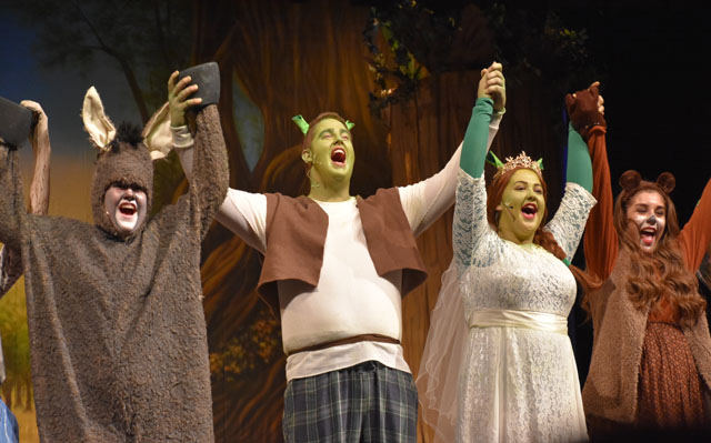Taking+a+bow+at+curtain+call%2C+the+cast+celebrates+another+successful+performance+of+Shrek+The+Musical.