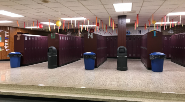 Recycling buckets located by the Junior Lockers