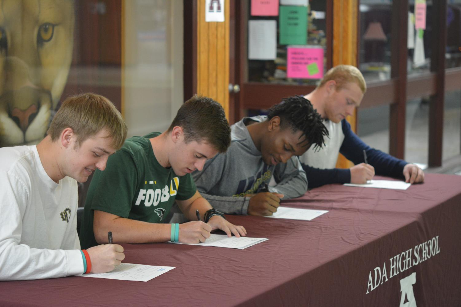 On National Signing Day, senior football players Christian Maloy, Jackson McFarlane, Kylen Cooper and Jacob Smalley put pen to paper, committing to their respective future teams.