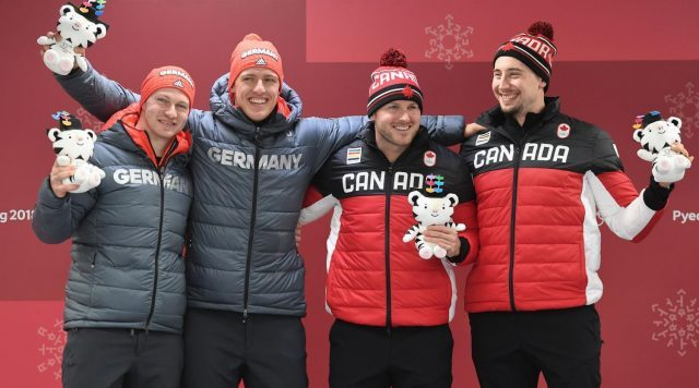 German and Canadian historically reach a tie in Bobsledding and are awarded First Place.