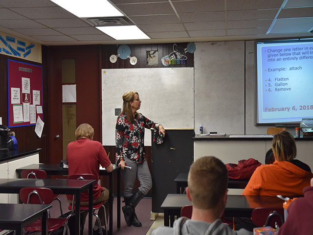 Reviewing this week's chapter, Shawn Freeman engages her students in an interactive class discussion.