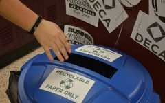 Ada High student shows his support for the recycling program and throws his trash away properly.