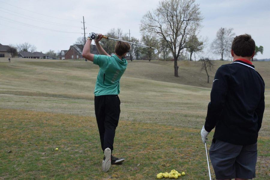 Varsity player Matthew Brown in the height of his back swing.