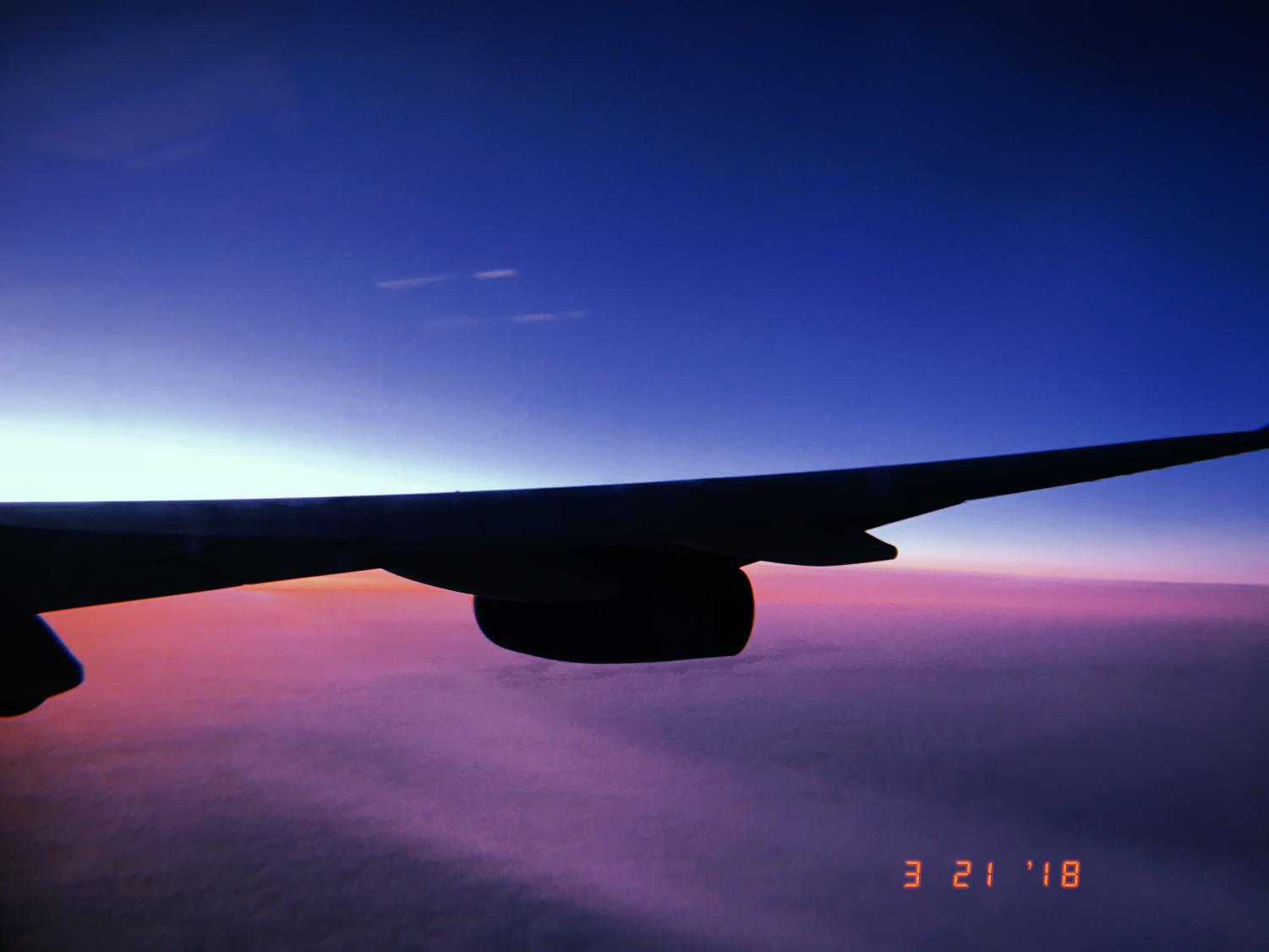 The+sun+rises+over+the+plane+that+is+taking+23+students+and+chaperones+to+the+country+of+England%2C+to+explore+the+city+of+London.+After+an+almost+nine+hour+flight%2C+completely+over+night%2C+the+first+glimpses+of+the+sun+coming+through+the+windows+were+a+sigh+of+relief%2C+knowing+landing+will+be+coming+up+soon.+