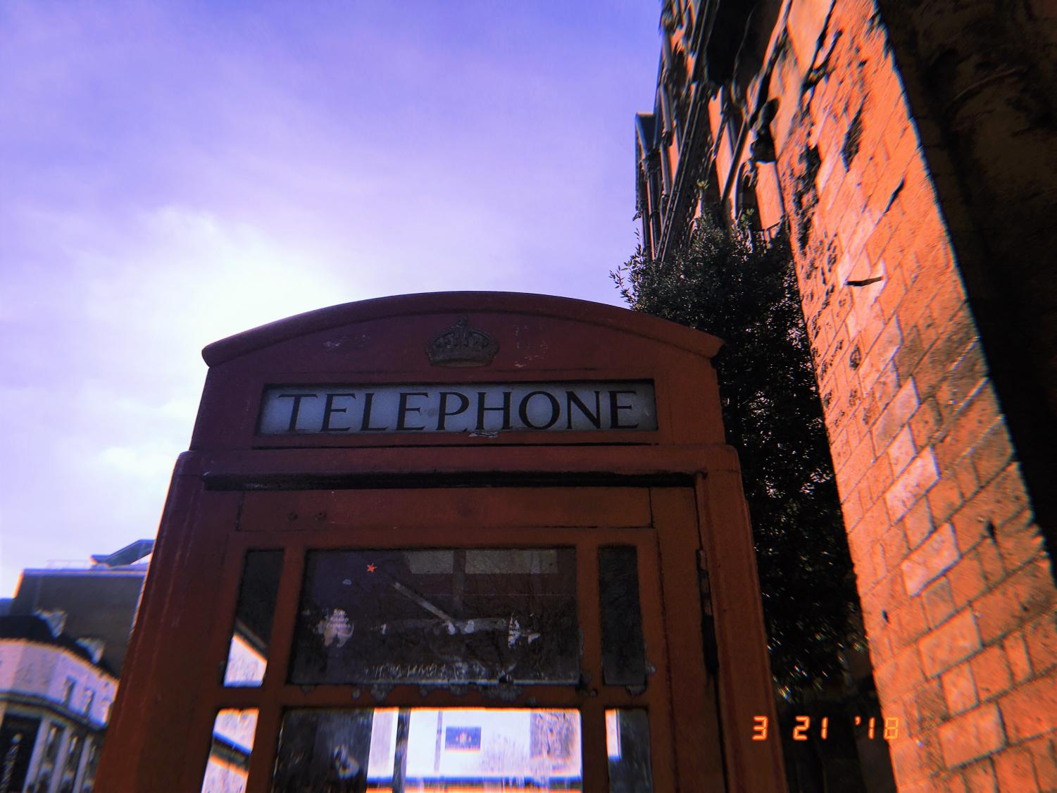 The+first+bright+red+telephone+booth+the+students+happened+upon+in+London+may+have+been+full+of+disgarded+litter+and+covered+in+graffiti%2C+but+it+was+still+an+opportunity+to+snap+pictures.+As+many+people+know%2C+the+telephone+booths+are+a+London+staple%2C+and+a+landmark+many+people+think+of+when+they+think+of+the+city.+Although+many+are+not+in+use+anymore%2C+they+remain+standing+for+tourists+to+take+pictures+in%2C+and+as+history+of+the+city.+