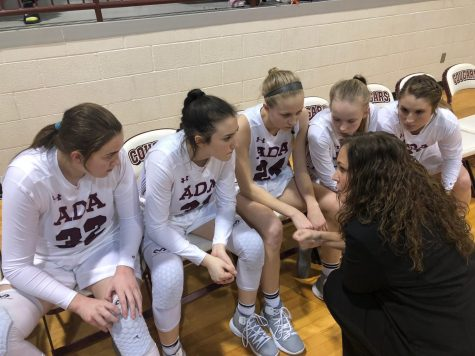 Head Coach Christie Jennings gives her team some quick advice during a time out.