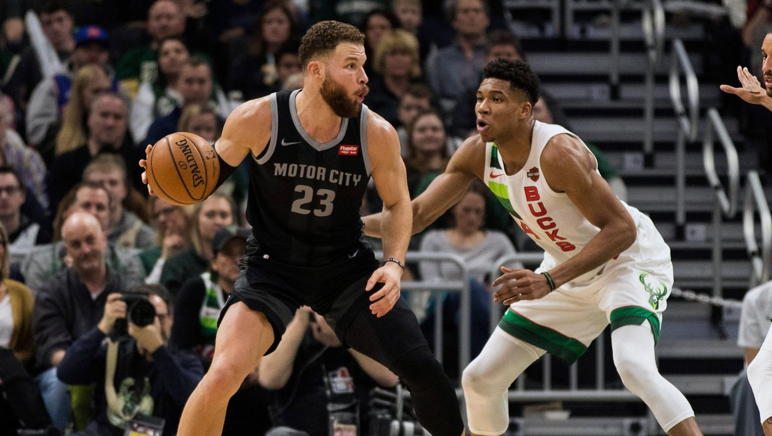 49986781ceb2 Photo by Jeff Hanish USA Today Sports Blake Griffin (23) backs down  defender Giannis (34).