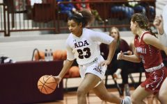 Dribbling down the court, sophomore Amaya Frizell went to score a layup. Frizell has been playing basketball for 10 years shows her heard work very well.