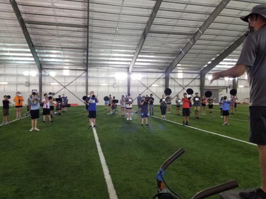 The Ada High marching band gets a jump start on practice during their early August band camp.