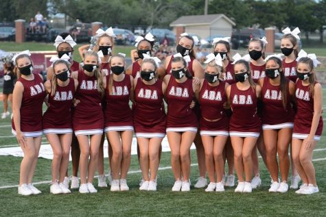 20-21 Ada High School Cheerleaders take the field for the first home game against Durant.
