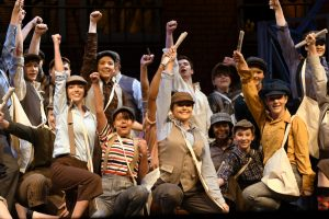 The cast of Ada High's production of Newsies perform
